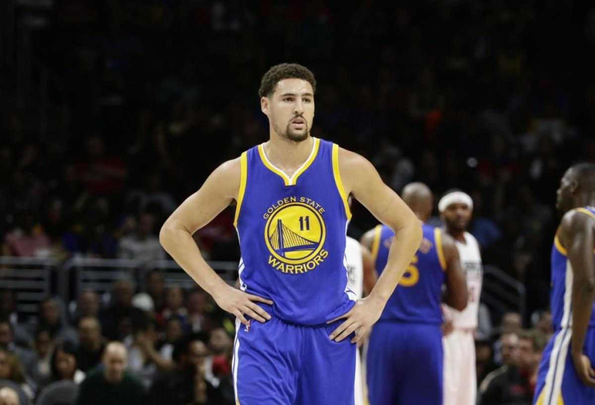 Golden State Warriors' Klay Thompson walks on the court during the first half of an NBA preseason basketball game against the Los Angeles Clippers, Tuesday, Oct. 20, 2015, in Los Angeles. (AP Photo/Jae C. Hong)