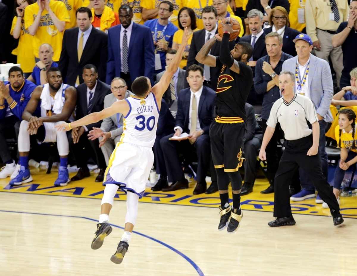Jun 19, 2016; Oakland, CA, USA; Cleveland Cavaliers guard Kyrie Irving (2) shoots the the game winning shot during the fourth quarter against Golden State Warriors guard Stephen Curry (30) in game seven of the NBA Finals at Oracle Arena. Mandatory Credit: Kelley L Cox-USA TODAY Sports