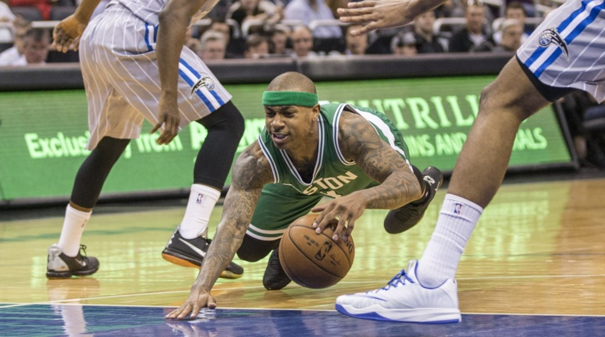 Boston Celtics guard Isaiah Thomas (4) looses his balance and goes down during the second half of an NBA basketball game in Orlando, Fla., Sunday, March 8, 2015. Magic won 103-98. (AP Photo/Willie J. Allen Jr.)