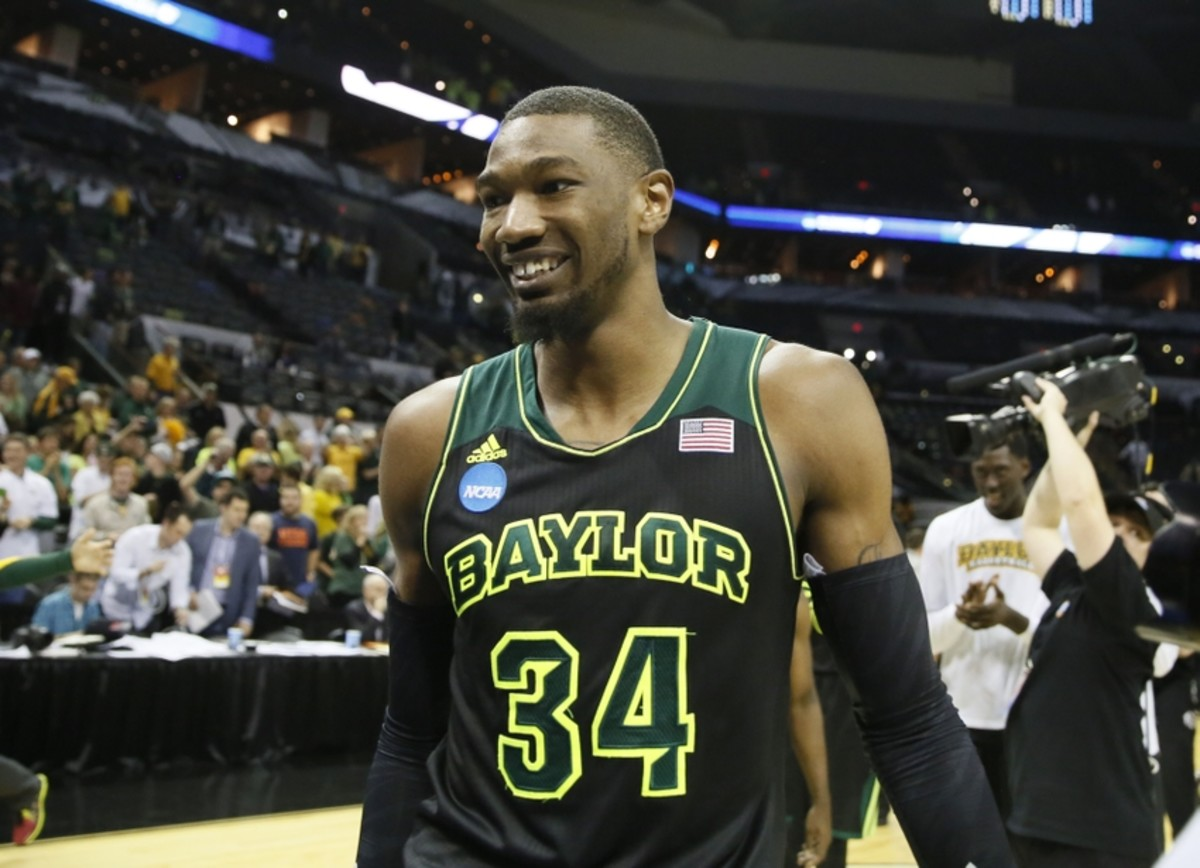 Mar 23, 2014; San Antonio, TX, USA; Baylor Bears forward Cory Jefferson (34) smiles as he walks off court after beating the Creighton Bluejays in a men's college basketball game during the third round of the 2014 NCAA Tournament at AT&T Center. Mandatory Credit: Soobum Im-USA TODAY Sports