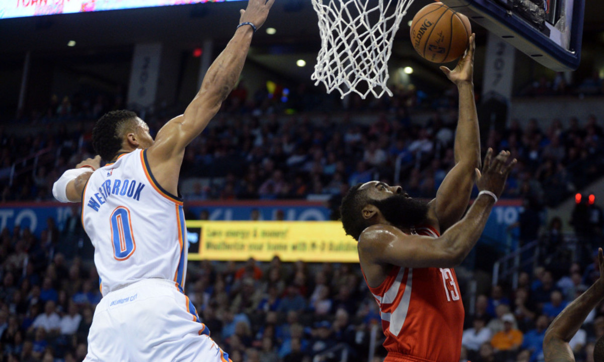Jan 29, 2016; Oklahoma City, OK, USA; Oklahoma City Thunder guard Russell Westbrook (0) blocks a shot attempt by Houston Rockets guard James Harden (13) ;f1q; at Chesapeake Energy Arena. Mandatory Credit: Mark D. Smith-USA TODAY Sports ORG XMIT: USATSI-232696 ORIG FILE ID:  20160129_pjc_ax3_042.JPG