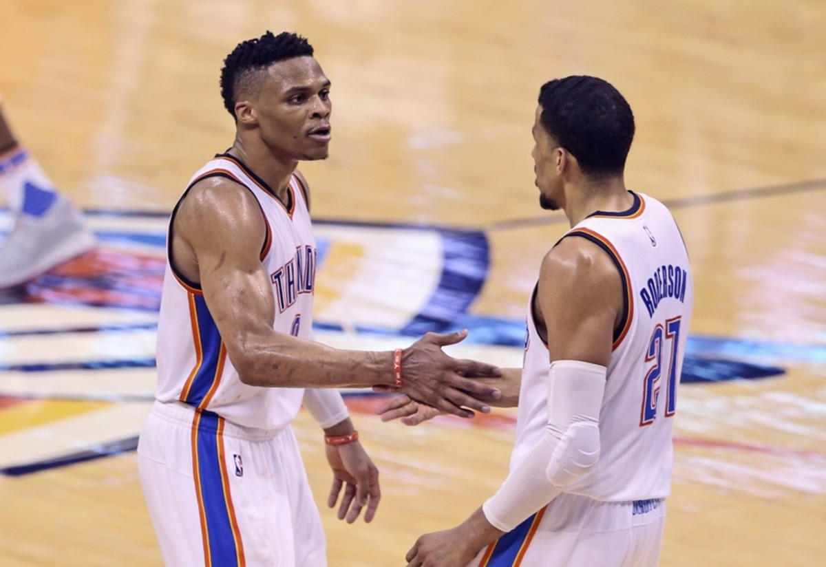 May 24, 2016; Oklahoma City, OK, USA; Oklahoma City Thunder guard Russell Westbrook (0) celebrates with  guard Andre Roberson (21) during the fourth quarter against the Golden State Warriors in game four of the Western conference finals of the NBA Playoffs at Chesapeake Energy Arena. Mandatory Credit: Kevin Jairaj-USA TODAY Sports