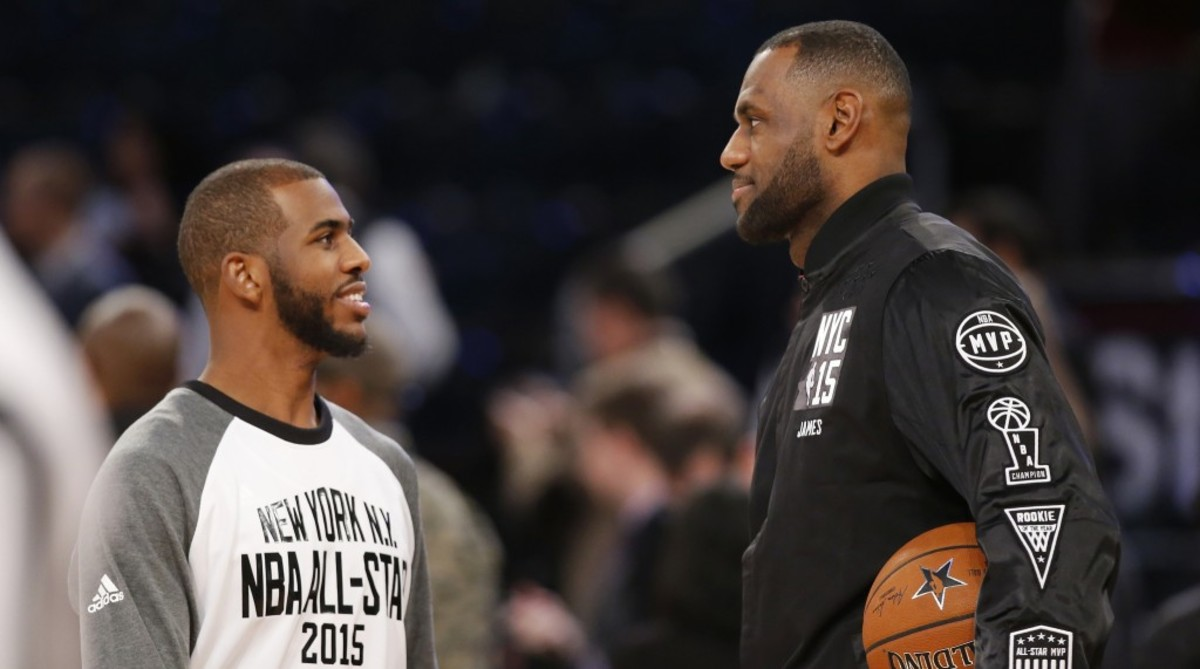 East Team's LeBron James, right, of the Cleveland Cavaliers, talks to West Team's Chris Paul, of the Los Angeles Clippers, prior to the start of the NBA All-Star basketball game, Sunday, Feb. 15, 2015, in New York. (AP Photo/Kathy Willens)