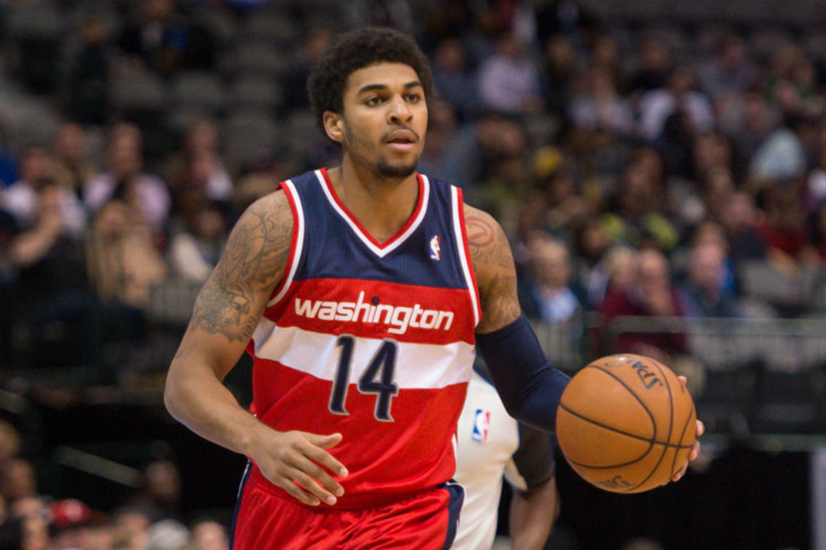 Nov 12, 2013; Dallas, TX, USA; Washington Wizards shooting guard Glen Rice Jr. (14) brings the ball up court against the Dallas Mavericks during the game at the American Airlines Center. The Mavericks defeated the Wizards 105-95. Mandatory Credit: Jerome Miron-USA TODAY Sports