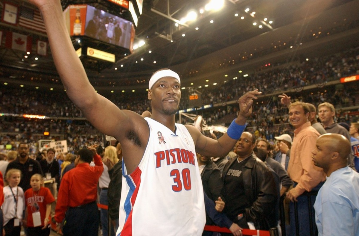 Detroit Pistons center Cliff Robinson (#30) celebrates after his team's victory over the Toronto Raptors, Thursday, May 2, 2002, at The Palace in Auburn Hills, Mich.  The Pistons won, 85-82.