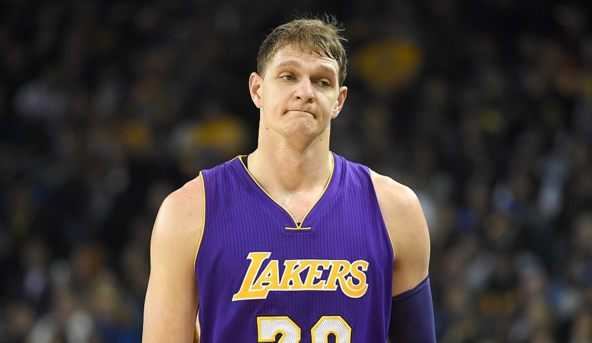 OAKLAND, CA - NOVEMBER 23:  Timofey Mozgov #20 of the Los Angeles Lakers reacts as he walks off the court after picking up his third personl foul against the Golden State Warriors in the first quarter of their NBA basketball game at ORACLE Arena on November 23, 2016 in Oakland, California. NOTE TO USER: User expressly acknowledges and agrees that, by downloading and or using this photograph, User is consenting to the terms and conditions of the Getty Images License Agreement.  (Photo by Thearon W. Henderson/Getty Images)