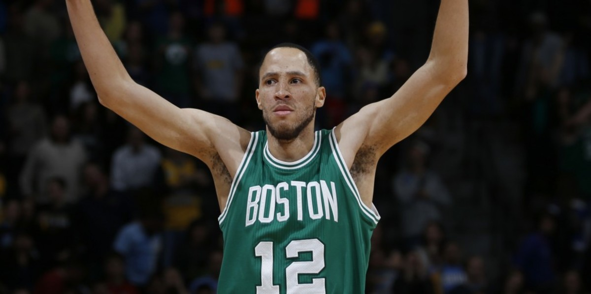 Boston Celtics forward Tayshaun Prince celebrates as time runs out  in the fourth quarter of an NBA basketball game against the Denver Nuggets on Friday, Jan. 23, 2015, in Denver. The Celtics won 100-99. (AP Photo/David Zalubowski)