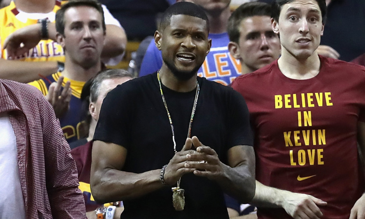 CLEVELAND, OH - JUNE 10:  Recording artist Usher attends Game 4 of the 2016 NBA Finals between the Golden State Warriors and the Cleveland Cavaliers at Quicken Loans Arena on June 10, 2016 in Cleveland, Ohio. NOTE TO USER: User expressly acknowledges and agrees that, by downloading and or using this photograph, User is consenting to the terms and conditions of the Getty Images License Agreement.  (Photo by Ronald Martinez/Getty Images) ORG XMIT: 643779587 ORIG FILE ID: 539322414
