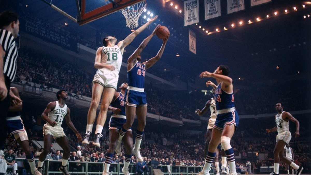 BOSTON - 1968:  Bailey Howell #18 of the Boston Celtics battles for the rebound against Chet Walker #24 of the Philadelphia 76ers during a game played in 1968 at the Boston Garden in Boston, Massachusetts. NOTE TO USER: User expressly acknowledges and agrees that, by downloading and or using this photograph, User is consenting to the terms and conditions of the Getty Images License Agreement. Mandatory Copyright Notice: Copyright 1968 NBAE (Photo by Dick Raphael/NBAE via Getty Images)