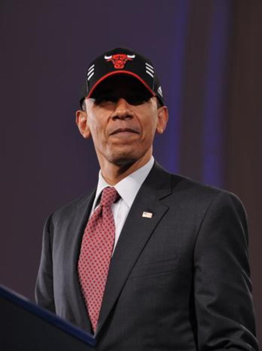 US President Barack Obama wears a Chicago Bulls cap after speaking at a DNC fundraiser April 14, 2011 at the Navy Pier in Chicago. Obama is in Chicago to attend a series of DNC fundraisers. AFP PHOTO/Mandel NGAN (Photo credit should read MANDEL NGAN/AFP/GettyImages)