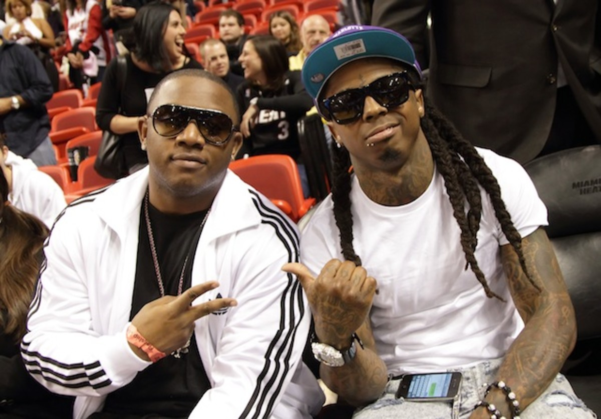 MIAMI, FL - DECEMBER 13: Mack Maine and Lil Wayne attend the Miami Heat vs New Orleans Hornets game at AmericanAirlines Arena on December 13, 2010 in Miami, Florida. (Photo by Alexander Tamargo/Getty Images)