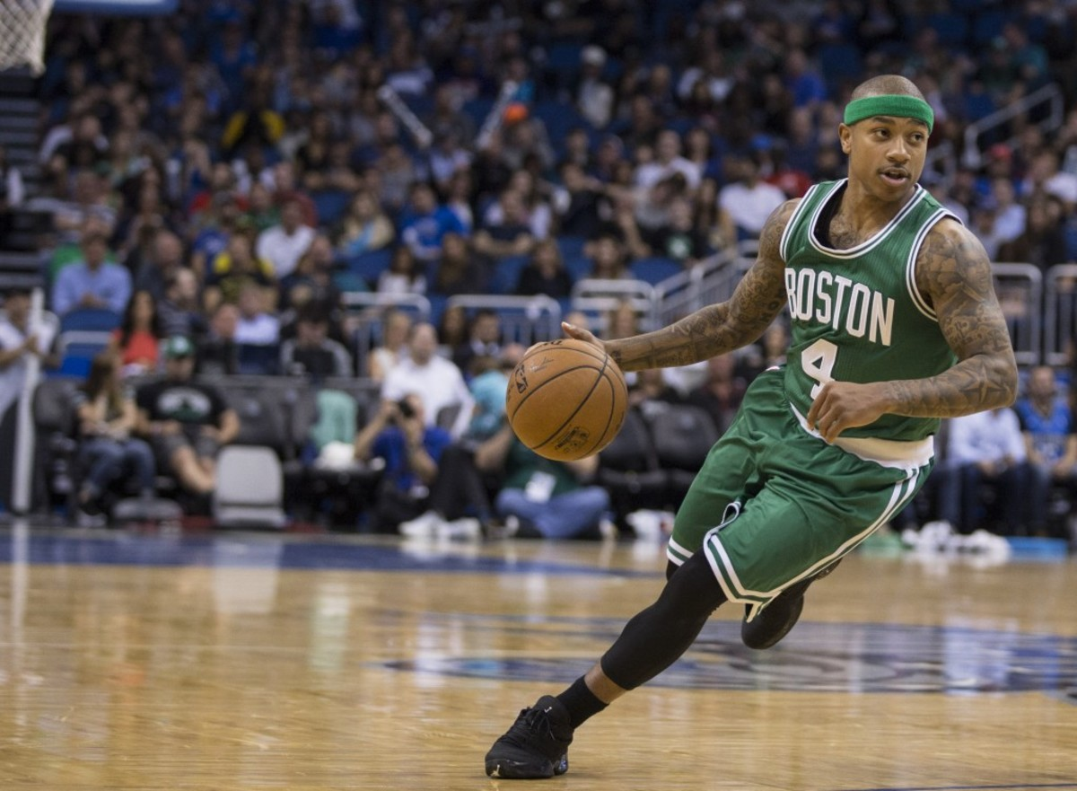 Boston Celtics guard Isaiah Thomas (4) dribbles down court against the Orlando Magic during the first half of an NBA basketball game in Orlando, Fla., Sunday, March 8, 2015. (AP Photo/Willie J. Allen Jr.)