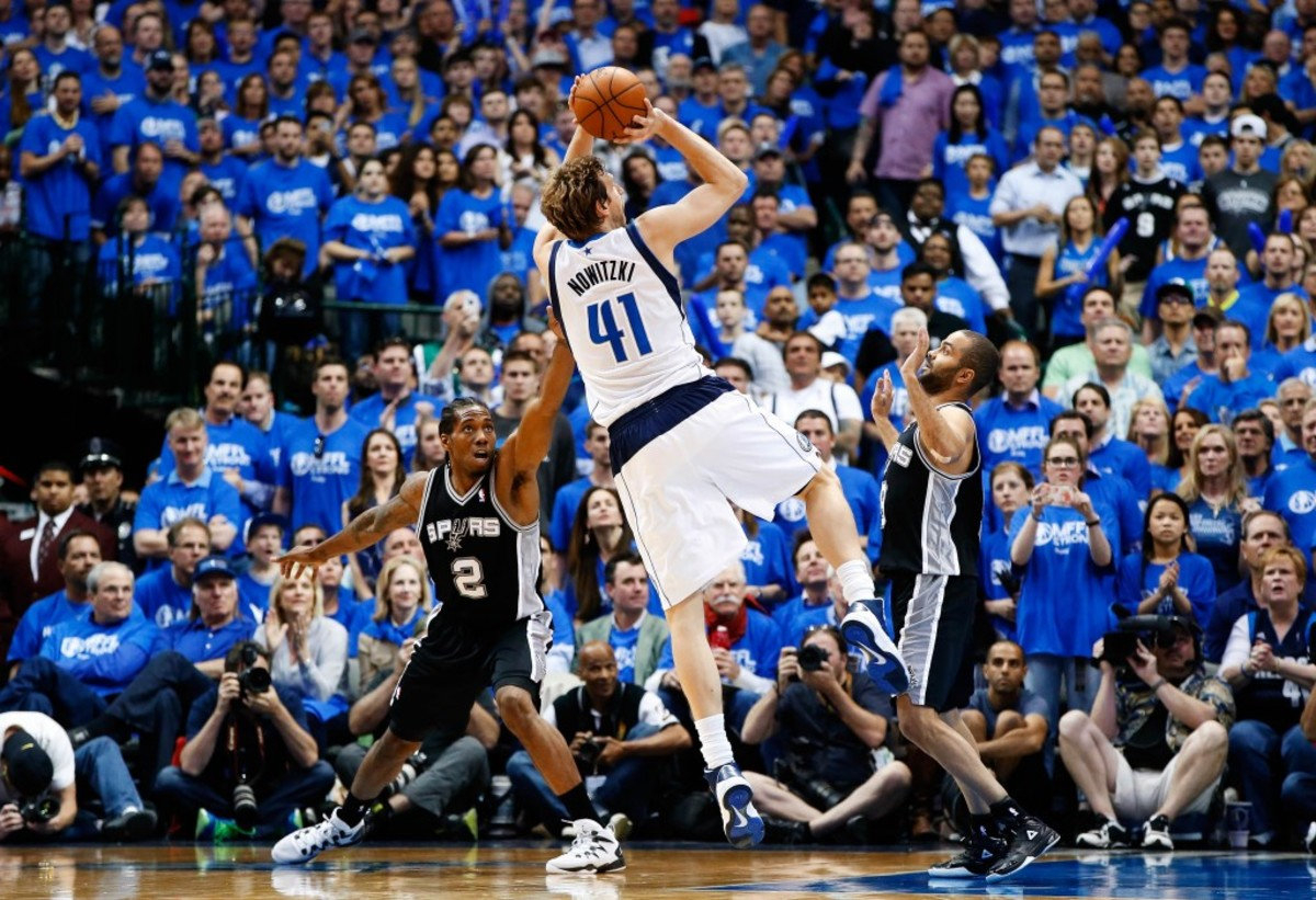 May 2, 2014; Dallas, TX, USA; Dallas Mavericks forward Dirk Nowitzki (41) shoots over San Antonio Spurs guard Tony Parker (right) during the game against the San Antonio Spurs in game six of the first round of the 2014 NBA Playoffs at American Airlines Center. Dallas won 113-111. Mandatory Credit: Kevin Jairaj-USA TODAY Sports