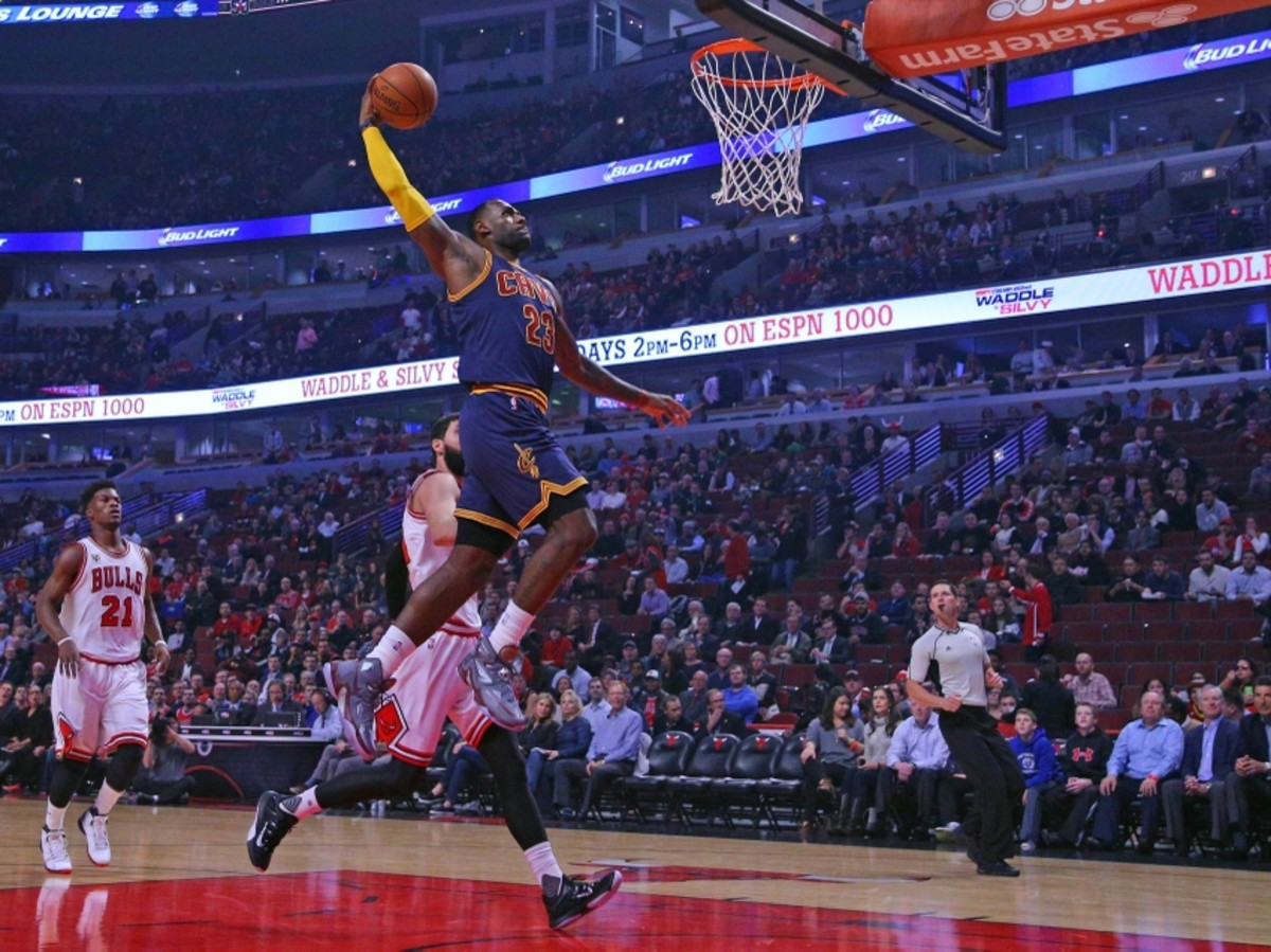 Oct 27, 2015; Chicago, IL, USA; Cleveland Cavaliers forward LeBron James (23) dunks over Chicago Bulls forward Nikola Mirotic (44) during the first half at the United Center. Mandatory Credit: Dennis Wierzbicki-USA TODAY Sports
