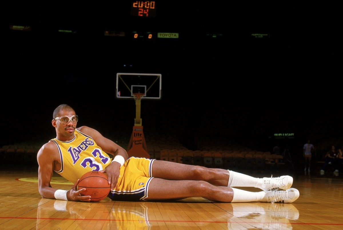 Undated: Kareem Abdul- Jabbar of the Los Angeles Lakers poses for the camera as he lays on the court.  Mandatory Credit: Rick Stewart  /Allsport