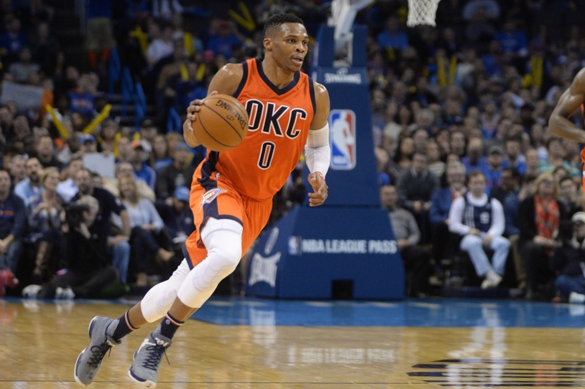 Jan 6, 2016; Oklahoma City, OK, USA;  Oklahoma City Thunder guard Russell Westbrook (0) dribbles the ball against the Memphis Grizzlies during the second quarter at Chesapeake Energy Arena. Mandatory Credit: Mark D. Smith-USA TODAY Sports