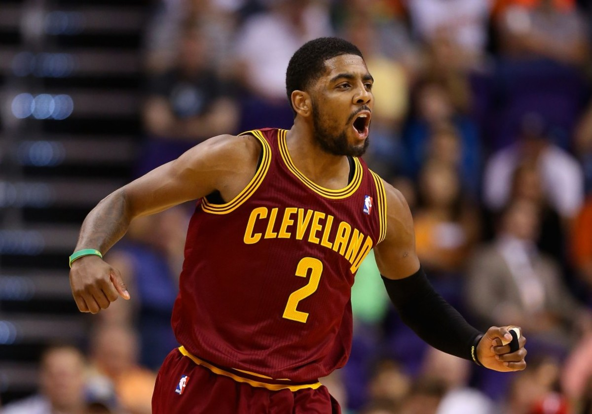 PHOENIX, AZ - MARCH 12:  Kyrie Irving #2 of the Cleveland Cavaliers celebrates after scoring against the Phoenix Suns during the second half of the NBA game at US Airways Center on March 12, 2014 in Phoenix, Arizona.  NOTE TO USER: User expressly acknowledges and agrees that, by downloading and or using this photograph, User is consenting to the terms and conditions of the Getty Images License Agreement.  (Photo by Christian Petersen/Getty Images)