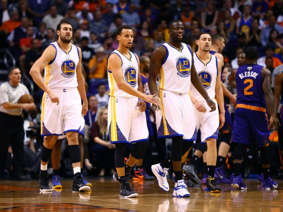Mar 9, 2015; Phoenix, AZ, USA; Golden State Warriors guard Stephen Curry (30) with forward Draymond Green (23) center Andrew Bogut (12) and guard Klay Thompson (11) against the Phoenix Suns at US Airways Center. The Warriors defeated the Suns 98-80. Mandatory Credit: Mark J. Rebilas-USA TODAY Sports