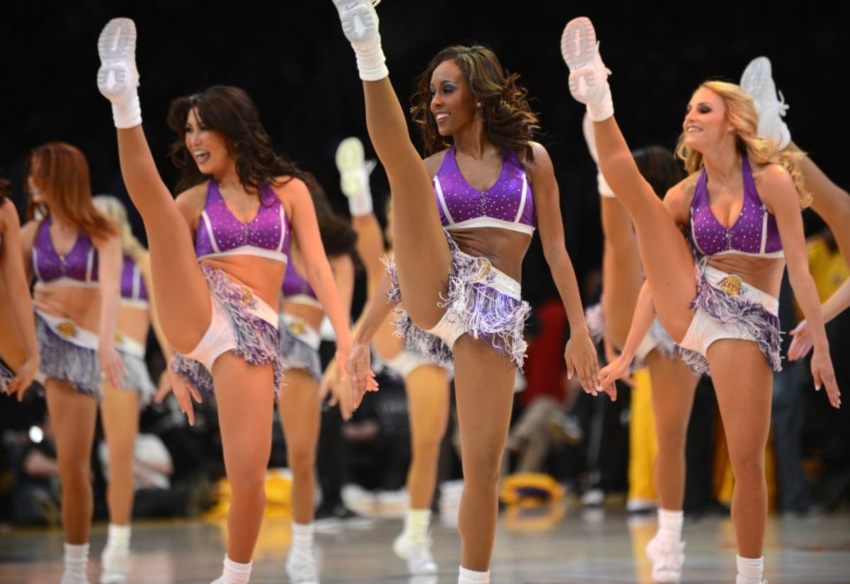 Los Angeles Lakers cheerleaders perform during an NBA basketball game against the Milwaukee Bucks at the Staples Center in Los Angeles on January 15, 2013.  AFP PHOTO/Robyn BECK        (Photo credit should read ROBYN BECK/AFP/Getty Images)
