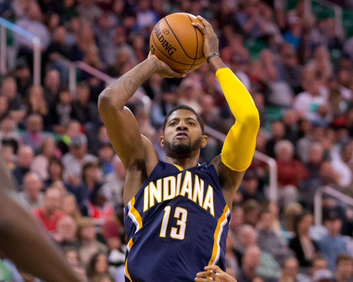 Dec 5, 2015; Salt Lake City, UT, USA; Indiana Pacers forward Paul George (13) shoots the ball during the second half against the Utah Jazz at Vivint Smart Home Arena. The Jazz won 122-119 in overtime. Mandatory Credit: Russ Isabella-USA TODAY Sports