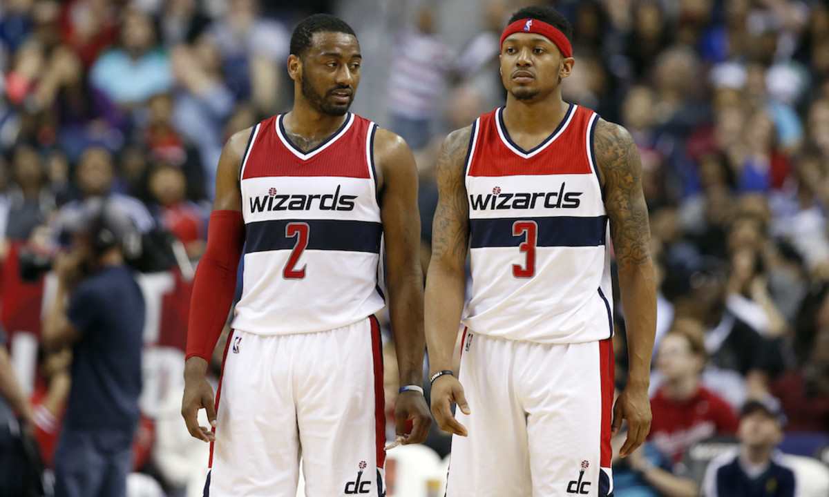 In this photo taken March 25, 2016, Washington Wizards guard John Wall (2) and Washington Wizards guard Bradley Beal (3) stand on the court during an NBA basketball game against the Minnesota Timberwolves, in Washington. With only one ball on the court at any given time, Wall and Beal know they have to share it. Wall and Beal have to share the ball on last-second shots and the limelight in the backcourt as the Washington Wizards are trying to get back to the playoffs. Wall is healthy again after having surgery on each knee, and Beal is fresh off signing a $128 million, five-year contract that ranked among the richest in the NBA this offseason.  (AP Photo/Alex Brandon) ORG XMIT: WX111