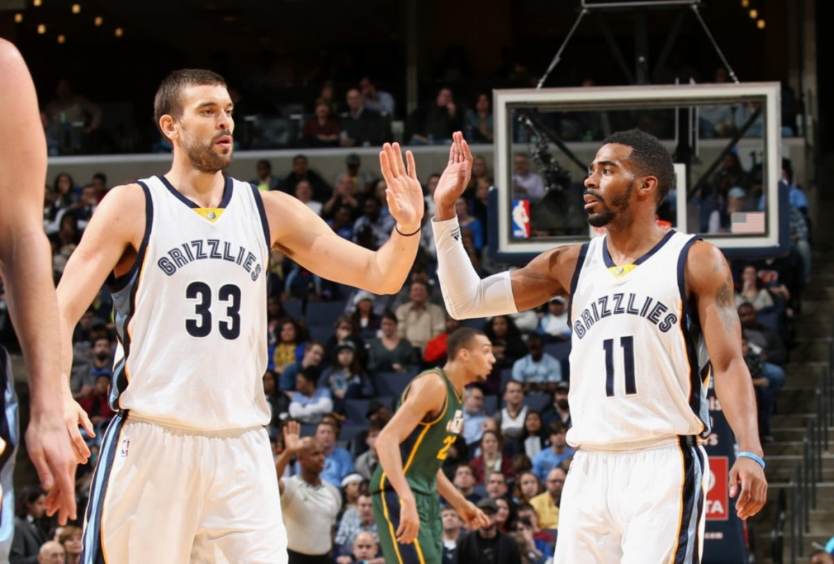 MEMPHIS, TN - DECEMBER 22: Marc Gasol #33 and Mike Conley #11 of the Memphis Grizzlies celebrate during a game against the Utah Jazz on December 22, 2014 at FedExForum in Memphis, Tennessee. NOTE TO USER: User expressly acknowledges and agrees that, by downloading and or using this photograph, User is consenting to the terms and conditions of the Getty Images License Agreement. Mandatory Copyright Notice: Copyright 2014 NBAE (Photo by Joe Murphy/NBAE via Getty Images)