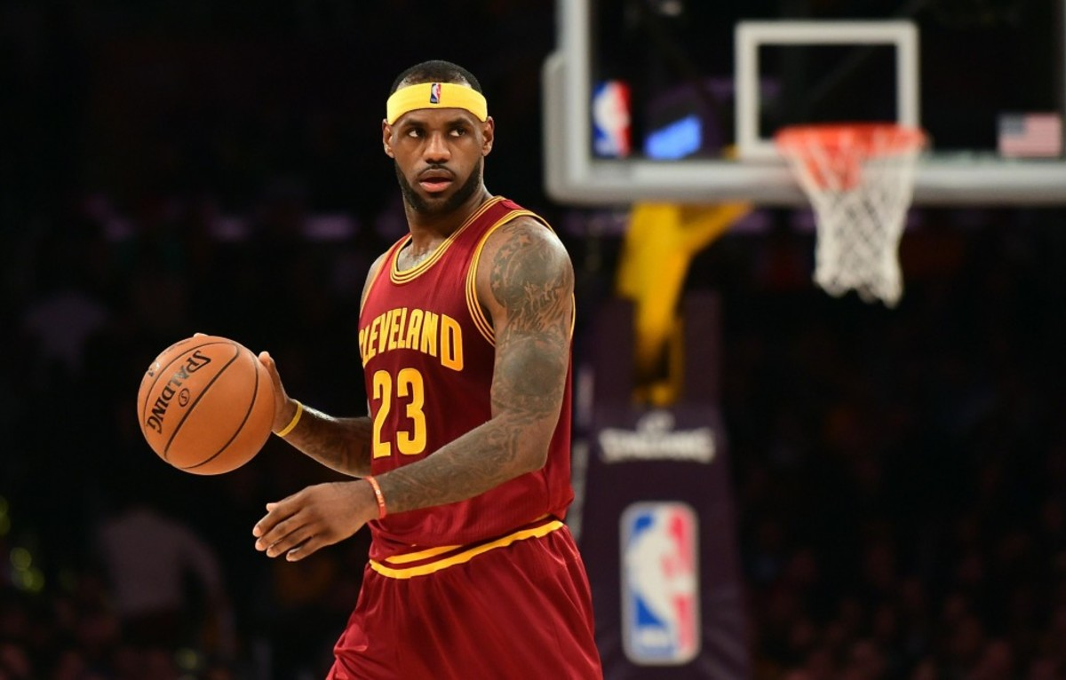 LeBron James of the Cleveland Cavaliers looks to pass against the Los Angeles Lakers during their NBA game at Staples Center in Los Angeles, California on January 15, 2014.  AFP PHOTO/Frederic J. BROWN        (Photo credit should read FREDERIC J. BROWN/AFP/Getty Images)