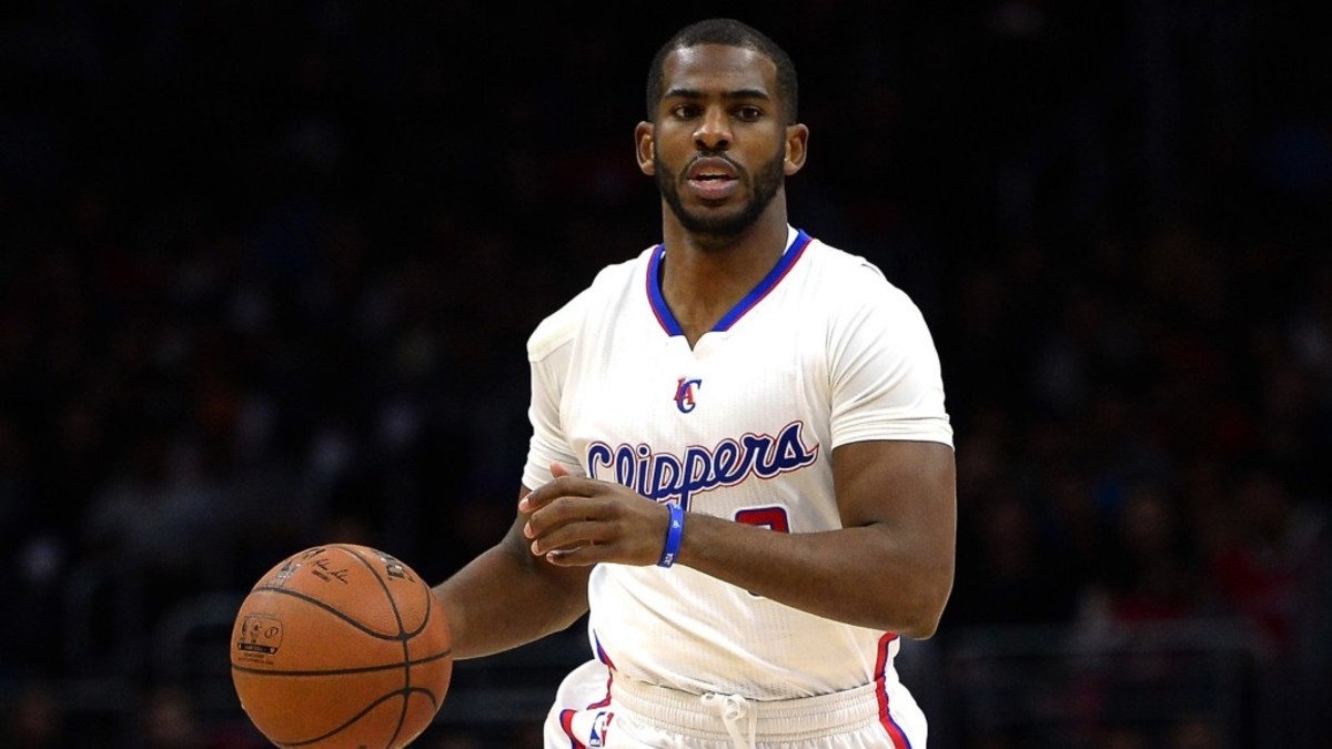 LOS ANGELES, CA - DECEMBER 29:  Chris Paul #3 of the Los Angeles Clippers dribbles up court against the Utah Jazz at Staples Center on December 29, 2014 in Los Angeles, California.   NOTE TO USER: User expressly acknowledges and agrees that, by downloading and or using this Photograph, user is consenting to the terms and condition of the Getty Images License Agreement.  (Photo by Harry How/Getty Images)
