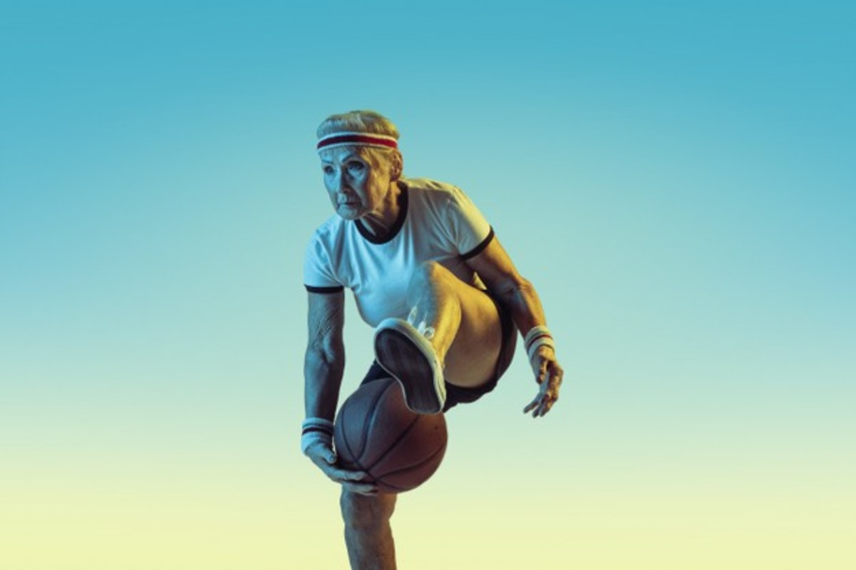 senior-woman-sportwear-playing-basketball-gradient-background-neon-light-female-model-great-shape-stays-active-concept-sport-activity-movement-wellbeing-confidence-copyspace_155003-30872